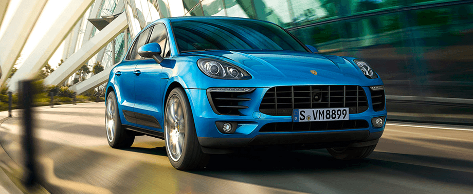 2018 Porsche Macan Base Side Exterior in Red— hover for lifestyle exterior
